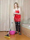Woman washes the floor with mop Stock Photography