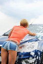 Woman washes her car Royalty Free Stock Photos