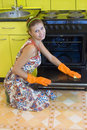 The woman washes an oven Stock Photo