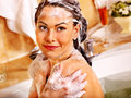 Woman washing hair in bubble bath happy Royalty Free Stock Photos