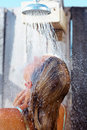 Woman washing hair under shower Royalty Free Stock Image