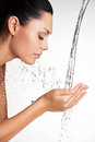 Woman washing her clean face with water closeup portrait of a beautiful Royalty Free Stock Images
