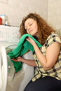Woman with washing machine Royalty Free Stock Photo