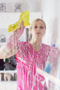 Woman washing the window glass young Royalty Free Stock Image