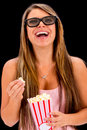 Woman watching a d movie with glasses and eating popcorn Stock Images