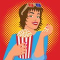 Woman watching a movie, smiling and eating popcorn