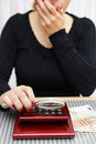 Woman watching sum on calculator with magnifying glass and cant believe numbers it Stock Photography