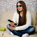 Woman watching tv in d glasses Royalty Free Stock Photos