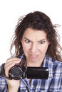 Woman watching video camera confused Stock Photography