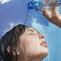Woman with water bottle Stock Photos