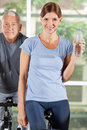 Woman with water in fitness center Royalty Free Stock Image