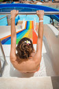Woman on water slide at a water park wants to move out Royalty Free Stock Photo