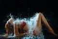 Woman And Water Splash In Dark Stock Image
