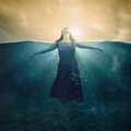 Woman in water a standing the deep waters with her head above the surface Royalty Free Stock Photography