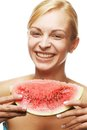 Woman with watermelon against white background ready to take a bite out of Royalty Free Stock Image
