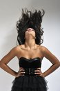 Woman waving dark hair Royalty Free Stock Photo