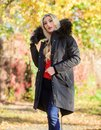 Woman wear black parka fur hood. Classic parka coat has become wardrobe icon. Versatile functional and stylish. Girl