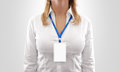 Woman wear blank white vertical badge mockup, stand isolated.