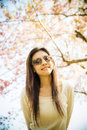 Woman wear eyeglass with pink cherry flower tree Royalty Free Stock Images