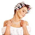 Woman wear hair curlers on head. Royalty Free Stock Photo