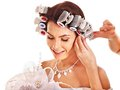 Woman wear hair curlers on head. Royalty Free Stock Image