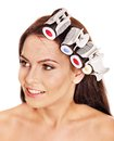 Woman wear hair curlers on head. Royalty Free Stock Photography