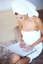 Woman Wearing Bath Towel Using Laptop Computer Royalty Free Stock Photo