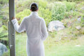 Woman wearing a bathrobe rear view of young Stock Photography