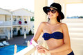 Woman wearing bikini standing on balcony Royalty Free Stock Photo