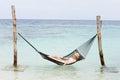 Woman Wearing Bikini And Sun Hat Relaxing In Beach Hammock Royalty Free Stock Photo