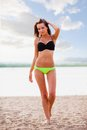 Woman wearing bikini walking on beach beautiful sexy brunette Royalty Free Stock Photo