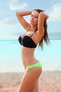 Woman wearing bikini walking on beach Royalty Free Stock Photo