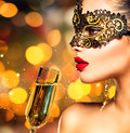 Woman wearing carnival mask with glass of champagne sexy model Royalty Free Stock Image