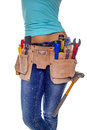 A woman wearing a diy tool belt full of a variety of useful tools on a white background Royalty Free Stock Photos