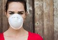Woman wearing a face mask an unhappy to deal with virus or pollution Royalty Free Stock Image