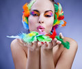 Woman wearing feather headress beautiful caucasian headdress and bright make up Royalty Free Stock Photos