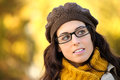 Woman wearing glasses autumn portrait cheerful fashion in scarf and wool cap brunette beautiful lady with eye wear Stock Photo