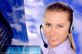 Woman wearing headset in office;could be reception Royalty Free Stock Photography