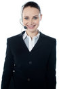 Woman wearing headsets, could be receptionist Stock Photography