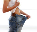 Woman wearing jeans after weight loss Stock Photo