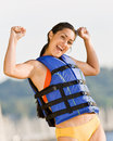 Woman wearing life jacket at beach Stock Image