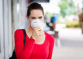 Woman wearing mask coughing a a face in the city Stock Photo