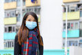 Woman wearing medical face mask i in crowded city Stock Photography