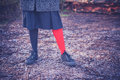 Woman wearing odd leggings on frosty ground a young is and is standing the in a forest a winter day Stock Photography
