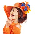 Woman wearing orange hat with flower. Royalty Free Stock Photo
