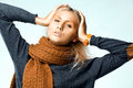 Woman wearing orange  scarf. Studio photo shooting Royalty Free Stock Image