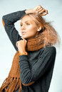 Woman wearing orange  scarf. Studio photo shooting Royalty Free Stock Photos