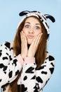 Woman wearing pajamas cartoon making silly face