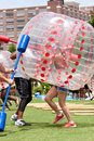 Woman wearing plastic ball runs bubble gauntlet at atlanta event ga usa july a a gets hit while running the field day in the old Royalty Free Stock Image