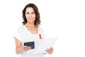 Woman wearing red aids awareness ribbon holding calculator Royalty Free Stock Photo